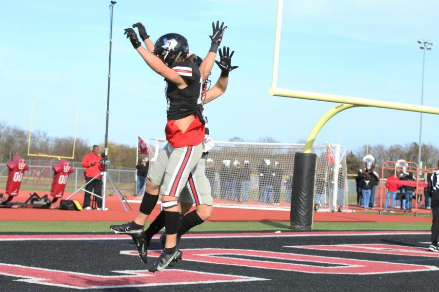 Senior Luke Mayfield and sophomore Jaxson Lavender celebrate after Mayfield scored a touchdown. The touchdown gave the Leopards a 27-point lead against the Trailblazers.