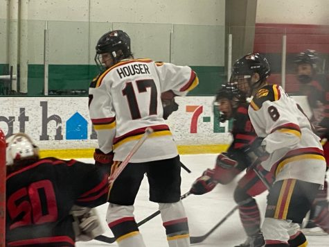 Junior Andrew Houser plays with his club team the Dallas Penguins. Houser also plays for the school.