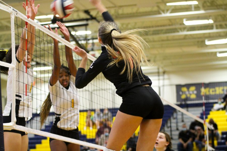 Senior Ellie Jonke hits the ball back to the Warriors players. The Leopards were undefeated going into playoffs.