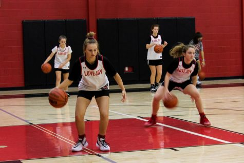 Freshman Skylar Rucker does a dribbling drill. The girl