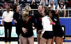 Junior Averi Carlson, sophomore Hannah Gonzalez and seniors Ellie Jonke, Callie Kemohah, Grace McLaughlin and Cecily Bramchreiber celebrate after a kill. The team was reacting to a kill by sophomore middle hitter Hannah Gonzalez.