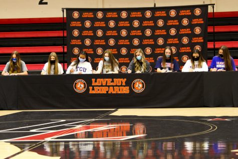 The eight seniors sign together for their intent to play at a collegiate level. Along with the six volleyball players, there was a golf and lacrosse player to sign.