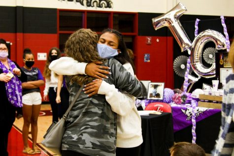 Senior Cecily Bramschreiber hugs one of the people who came to support her as she signed. Bramschreiber signed on to play volleyball for Texas Christian University.