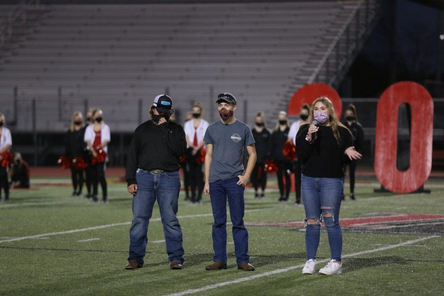 Seniors Cole Miller, Garrett Zale, and Paris Rajala speak on athletic training after walking out of the leopard head. Rajala is also a part of the yearbook staff.