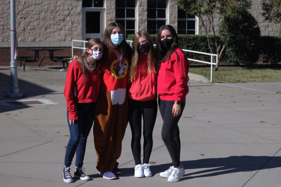 Sophomores Chloe Nelson, Savannah Starr, Genevieve Jones, and Alexa Adams all wear red for Red Out. Starr wore a onesie for this dress up day.