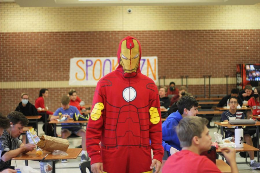 Senior Landon Snow wears an Iron Man onesie. Friday's dress up day went along with the game theme.