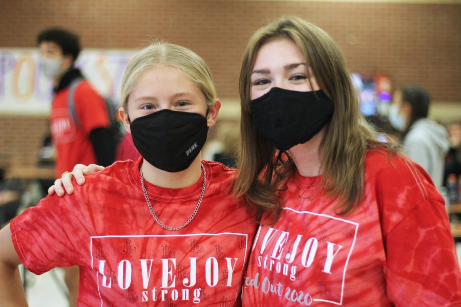 Freshmen Brooke Anderson and Grayson Shugart wear matching red out shirts. Friday's red out theme was the most dressed up for.
