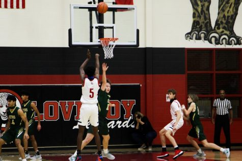 Junior Kidus Getenet makes a three-point shot in the second quarter. The Leopards begin district play on Tuesday, Jan. 1.