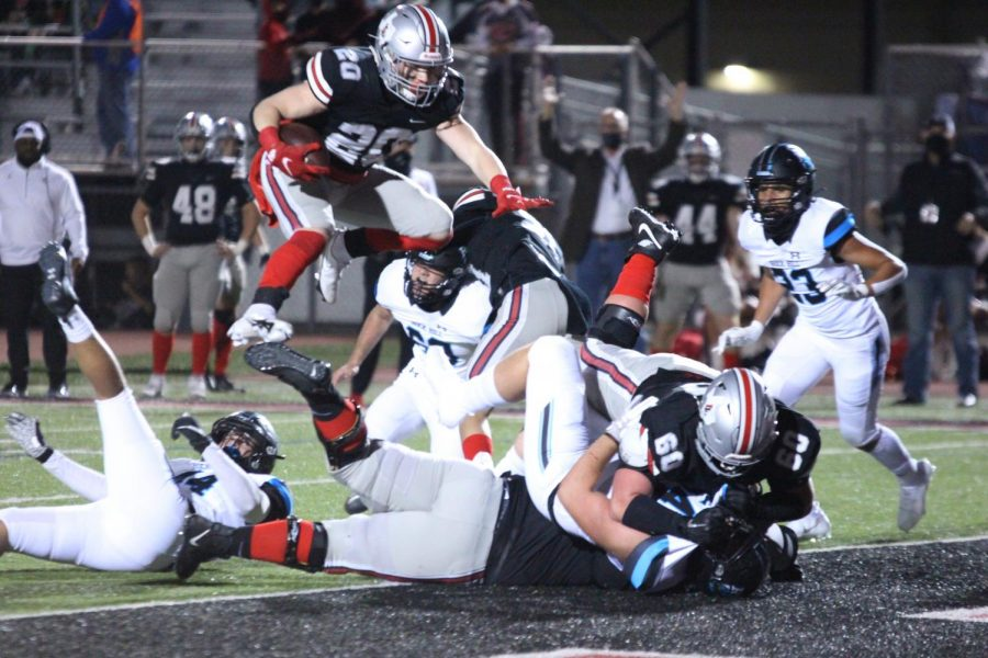 Junior linebacker Phillip Joest hurdles two Lovejoy and one Rockhill linemen for a touchdown. This touchdown put the Leopards up by 14.