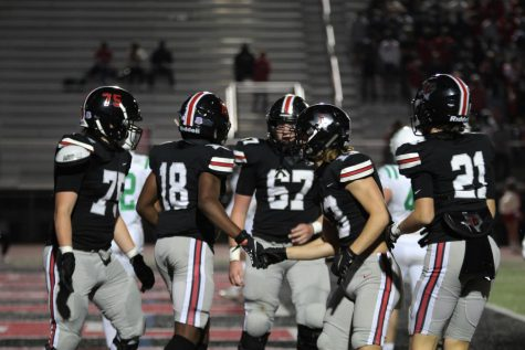 Seniors Luke Mayfield and Isaiah Smith shake hands after scoring a touchdown. The game finished with a final score of 70-7.