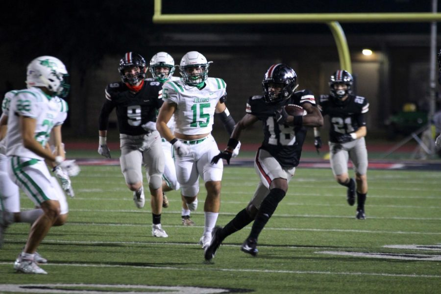 Senior running back Isaiah Smith runs the ball down the field in attempt to gain yardage. The Leopards will play the Frisco Raccoons this Friday.