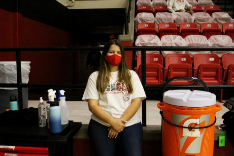"""Senior Jenna Kilpatrick works as the athletic trainer at the volleyball game. """"They originally started out with a joke saying that there was a practice that wasn"""
