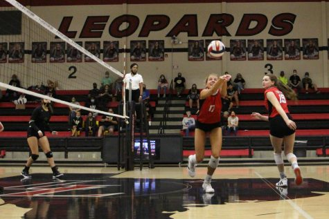 Junior Rosemary Archer bumps the ball to make the return. The Leopards win the point upon the return.
