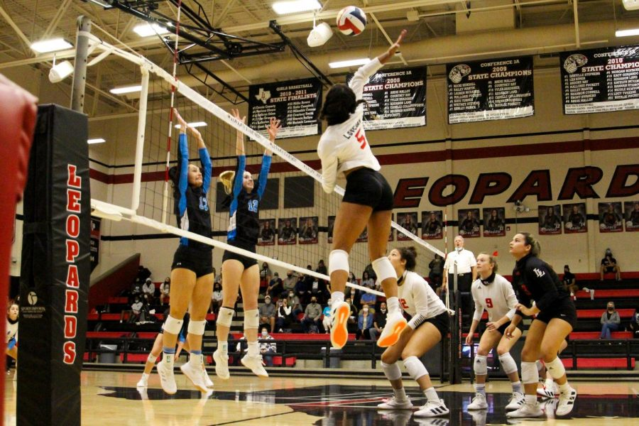 Senior Cecily Bramschreiber hits the ball for the return. Bramschreiber is committed to play volleyball for Texas Christian University.