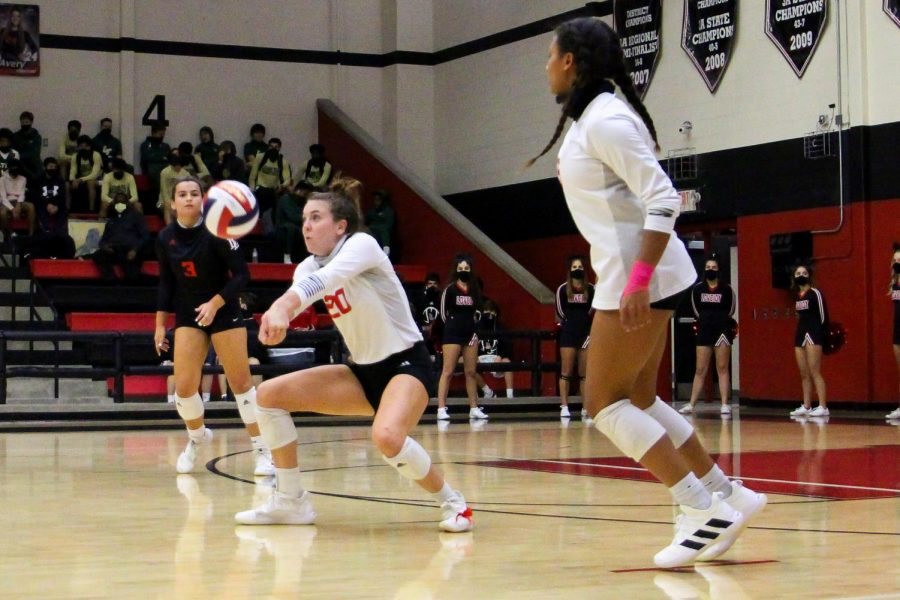 Senior Kylee Fitzsimmons bumps the ball to allow for the return. The Leopards win the point upon the return.