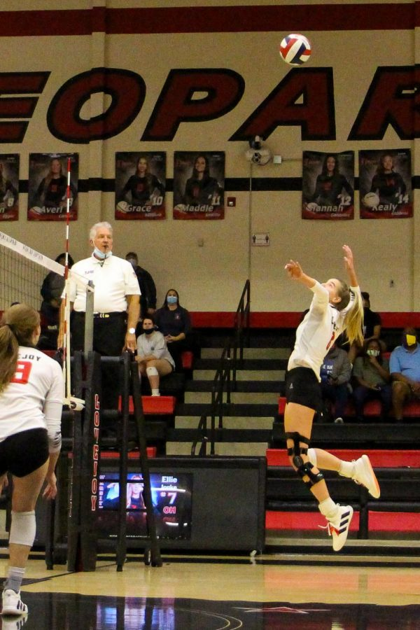 Senior Brynn Egger hits the ball for the return during the first match. The Leopards won the first match 25-11.