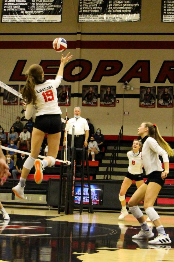 Senior Lexie Collins hits the ball for the return. The Leopards won the point upon Collins' return going right into a gap.