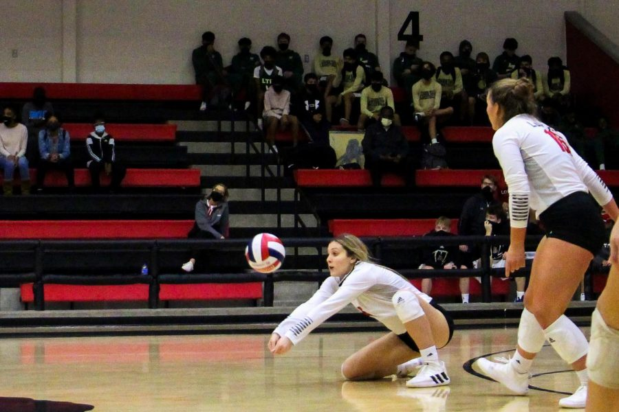 Junior Ava Camacho makes the dig to allow the return. The return is successful and wins the point for the Leopards.
