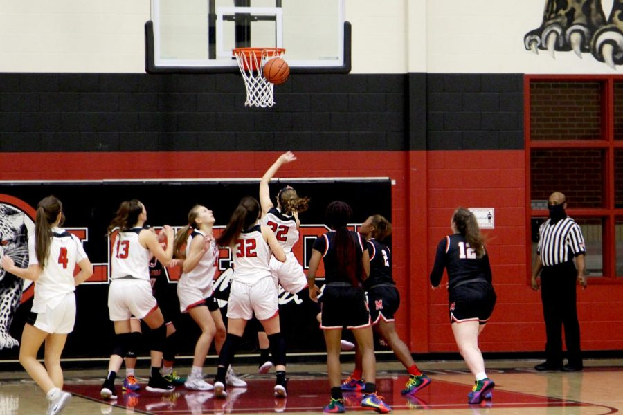 Junior Sydney Chapman attempts a shot for the Leopards. The shot was attempted during the first half.