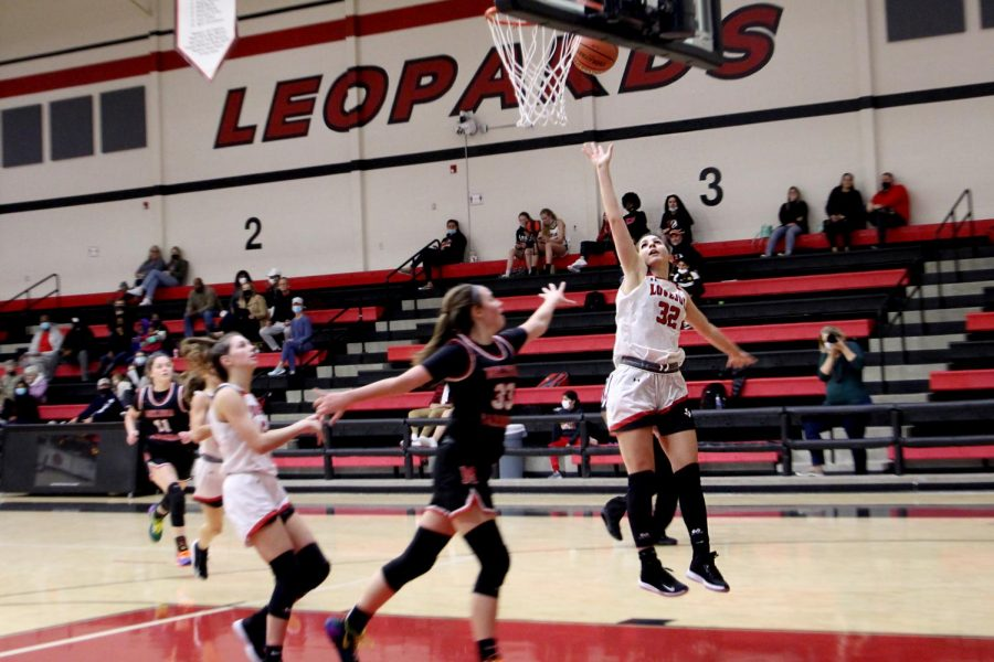 Senior Avae Odza shoots a layup. This basket was attempted during the second half.