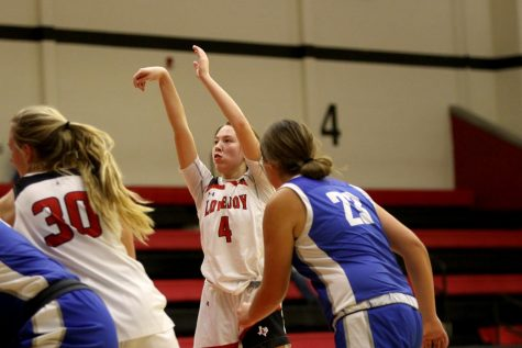 Sophomore Samantha Basson shoots for a point. Basson scored 28 points in the game.