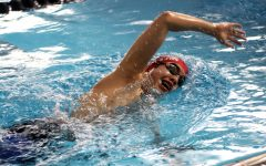 Freshmen Grant Hu swims a freestyle stroke at practice. Hu recently had double wins in the 500 free and the 100 back.