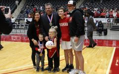 Ryan Mitchell celebrates with his family after winning the state championship. Mitchell was awarded a 2020 AVCA high school region coaches of the year award.