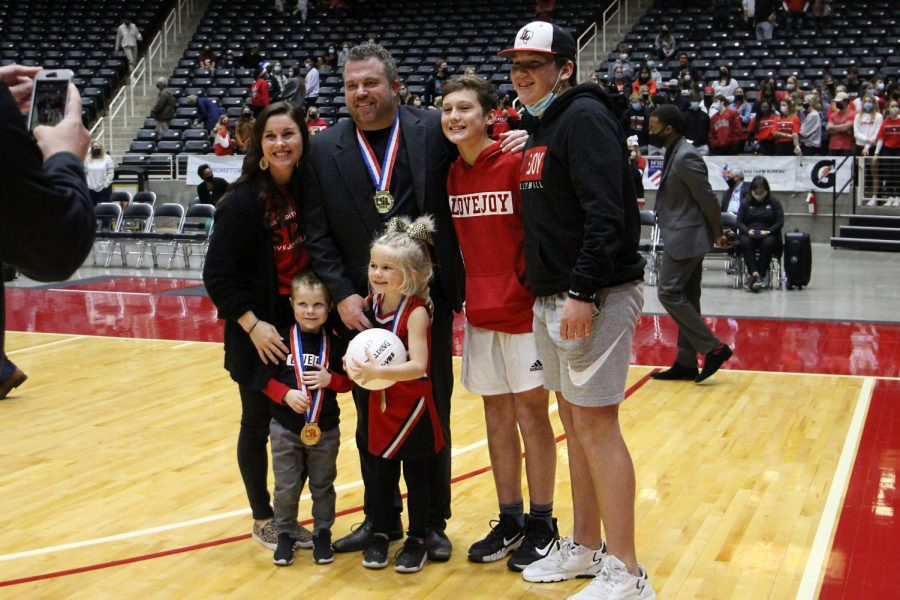 Ryan+Mitchell+celebrates+with+his+family+after+winning+the+state+championship.+Mitchell+was+awarded+a+2020+AVCA+high+school+region+coaches+of+the+year+award.