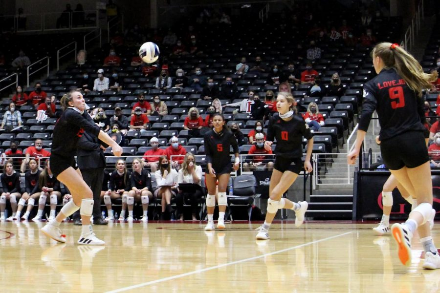 Senior Kylee Fitzsimmons bumps the ball to set up for junior Averi Carlson. The ball is returned to allow a continuing volley between the teams.