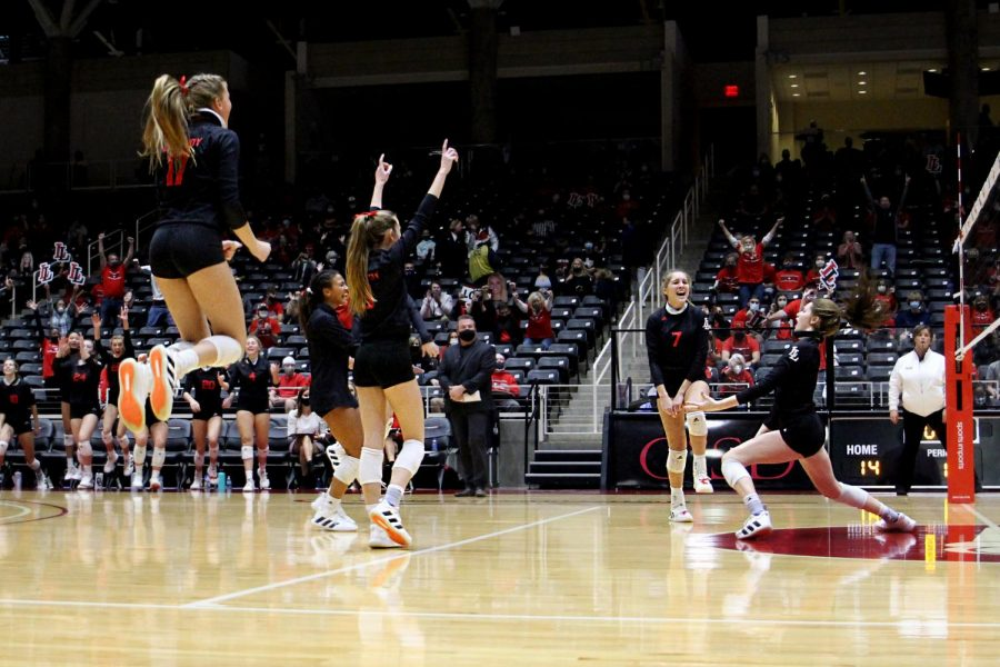 The Leopards celebrate after winning a point. The Leopards won the second set 25-17.