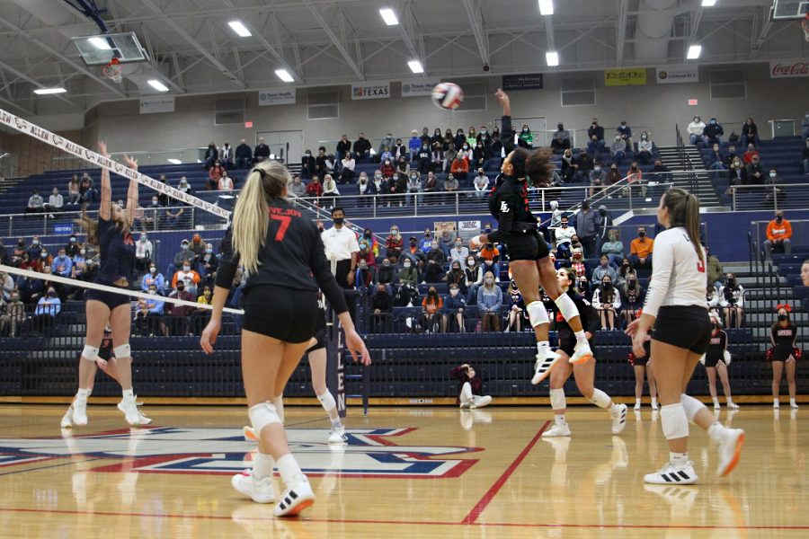 Senior Cecily Bramschreiber hits the ball to make the return. The Leopards won the point after along volly following Bramschreiber return.