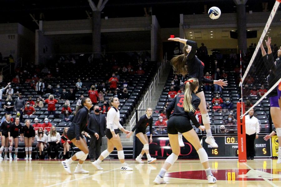 Senior Lexie Collins hits the ball for the return. Collins has committed to play for Wyoming volleyball.