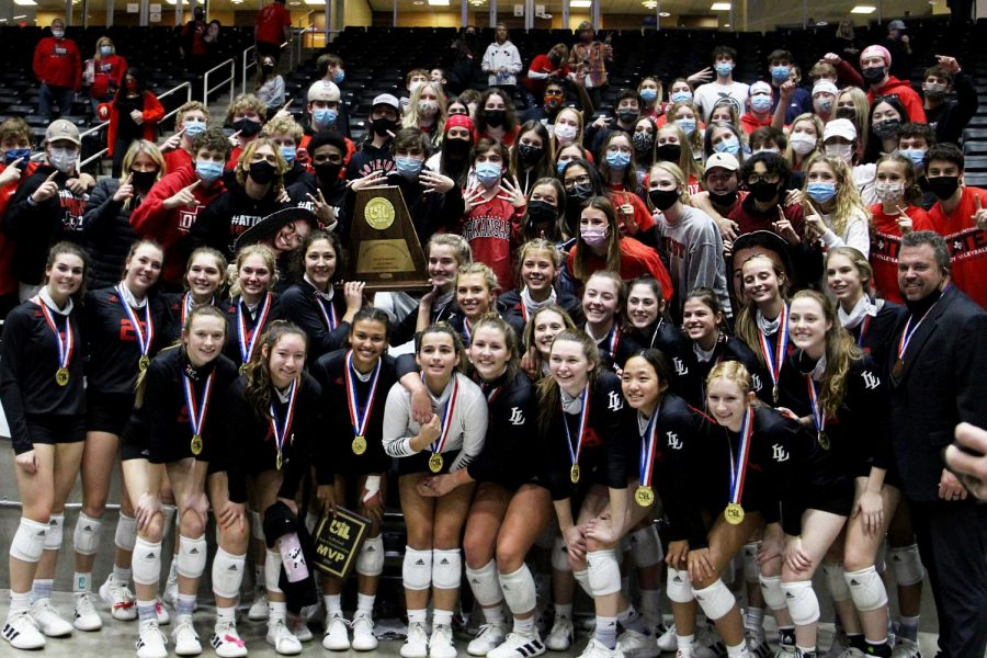 The Leopards take a photo with the student section after winning the state title. The Leopards finished their season with a 26-0 season record.