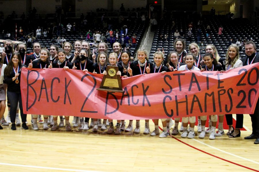 The Leopards pose with the 2020 state championship trophy. The team won back to back state championships.