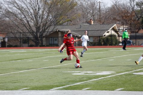 Senior Jordan Watson kicks the ball at the girls final game of the tournament. The team played three games in the tournament, winning all three of those before losing in the semifinals.