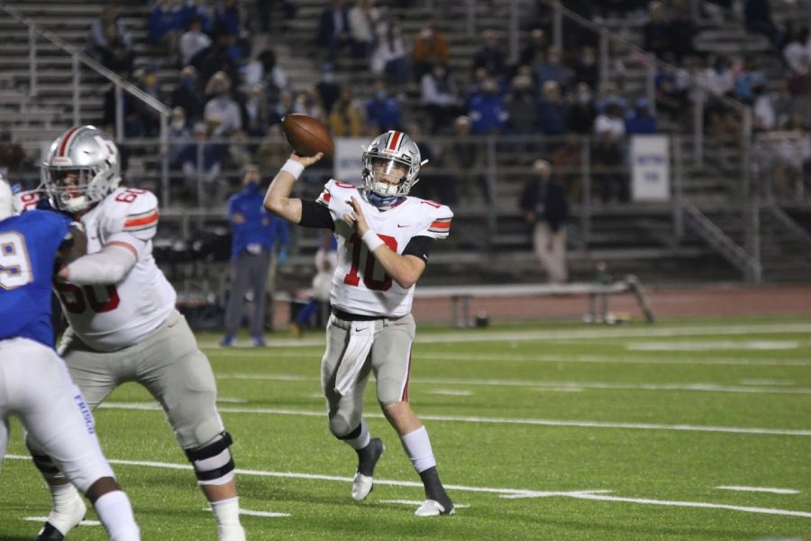Senior quarterback no. 10 Ralph Rucker passes the ball to senior Reid Westervelt. Rucker was nominated for the Landry Award based off of his playing and leadership from this season.
