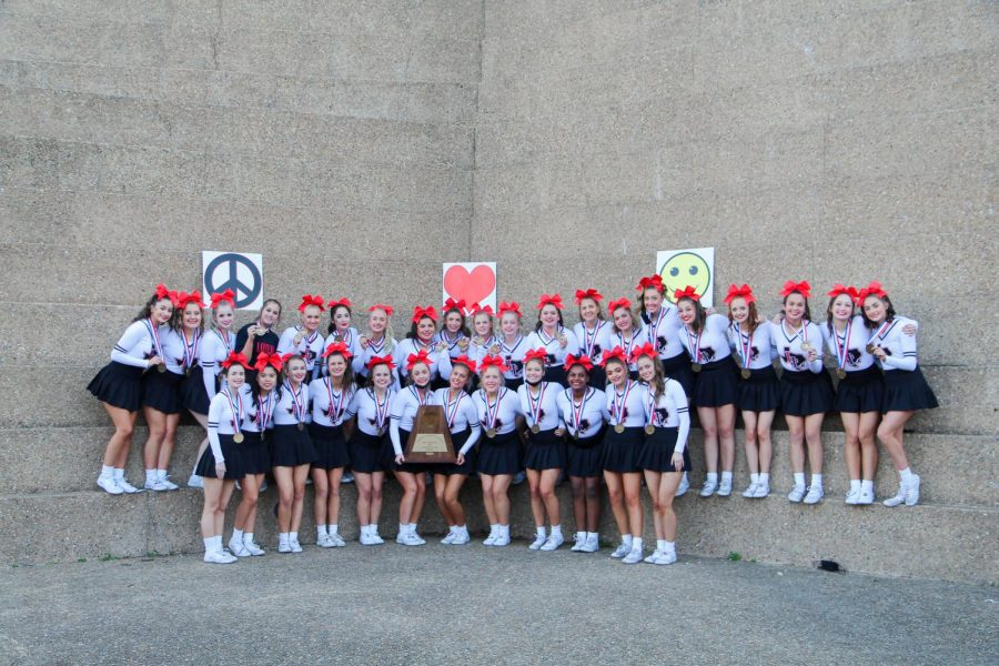 The UIL cheer team takes a photo with their third place trophy after receiving their medals. The team competed on Jan. 13 for the state competition.