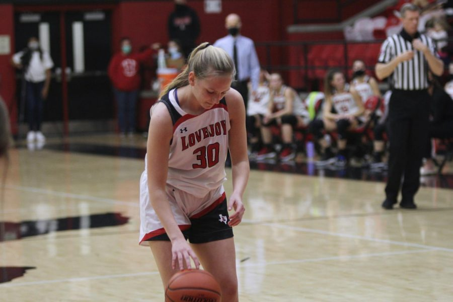 Sophomore+guard+no.+30+Linnea+Maddux+dribbles+in+place+before+shooting+her+free+throw.+Maddux+scored+two+points+for+the+Leopards.