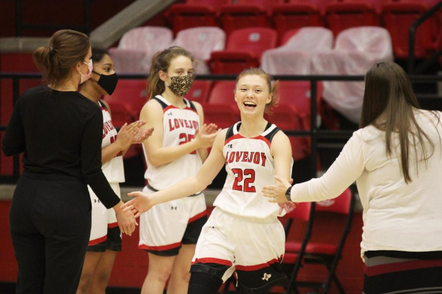 Junior Sydney Chapman high fives her teammates as her name is announced. The Lady Leopards next game will be tonight against Princeton.
