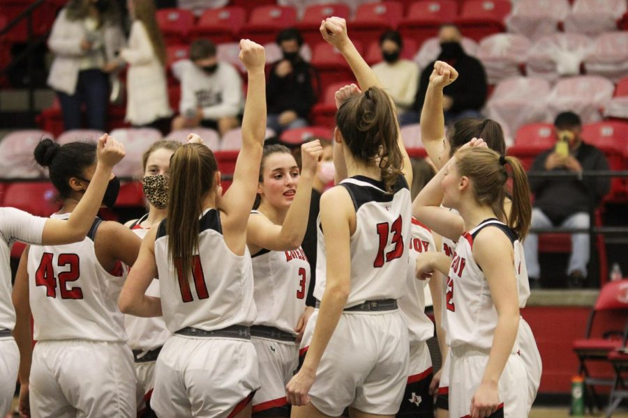 The Lady Leopards do their pre-game team breakout before heading onto the court. The game ended with a final score of 67-35 Raiders.