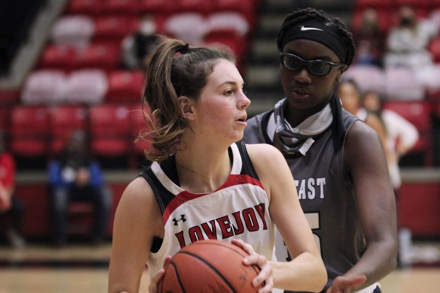 Senior Katie Dolberry looks for an opening to pass the ball to a teammate. Dolberry scored two points and had four rebounds and six blocks.