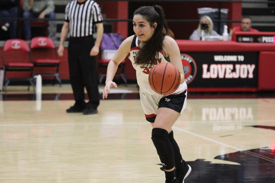 Senior Avae Otis dribbles down the court after stealing the ball from her opponent. Otis scored six points and made three rebounds for the Leopards.