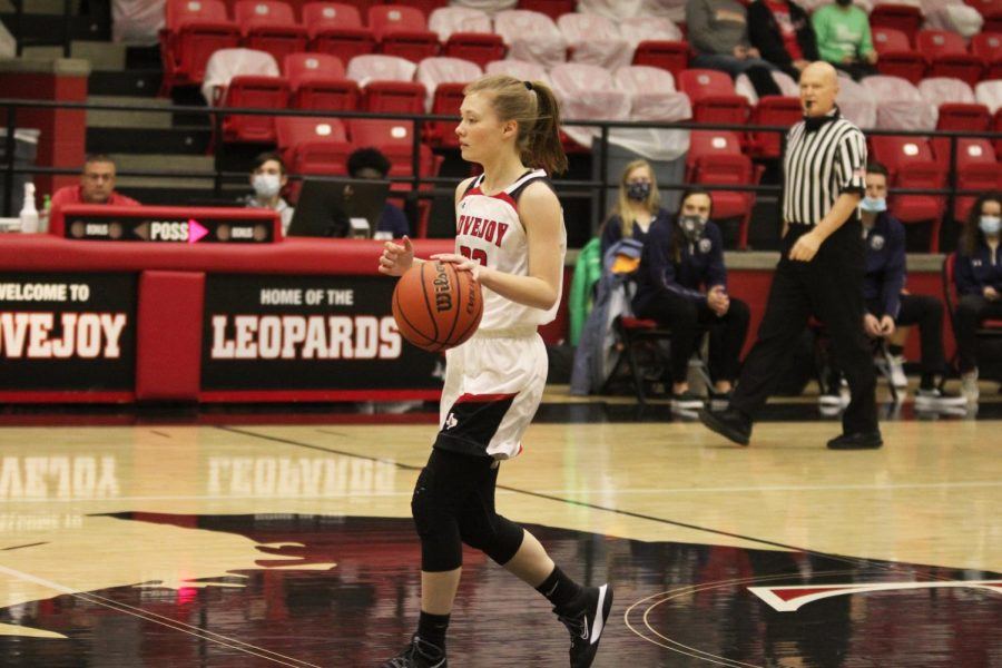 Junior Sydney Chapman looks for a teammate to pass the ball to. Chapman made two assists and one rebound for the leopards.