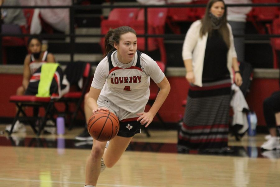 Sophomore Samantha Basson dribbles the ball to her teammates. Basson had three rebounds for the Leopards.