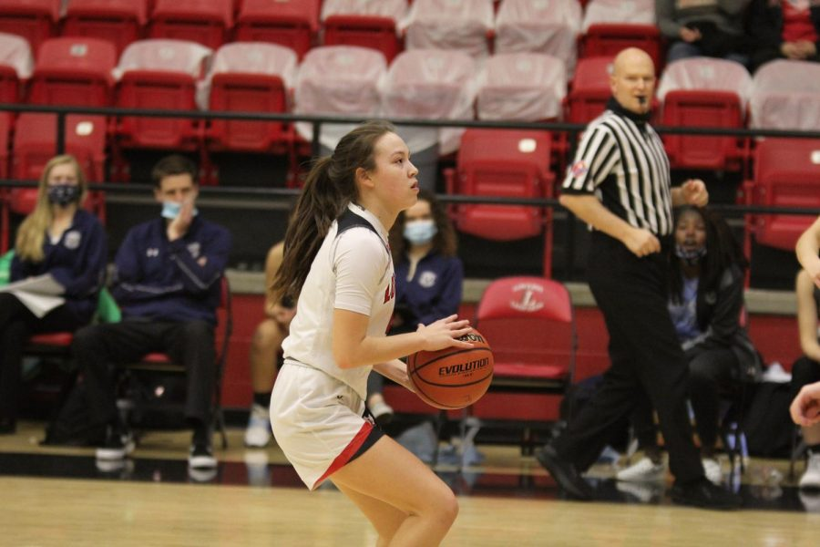 Sophomore Samantha Basson looks to the basket before taking a shot. Basson scored 23 points at this game.