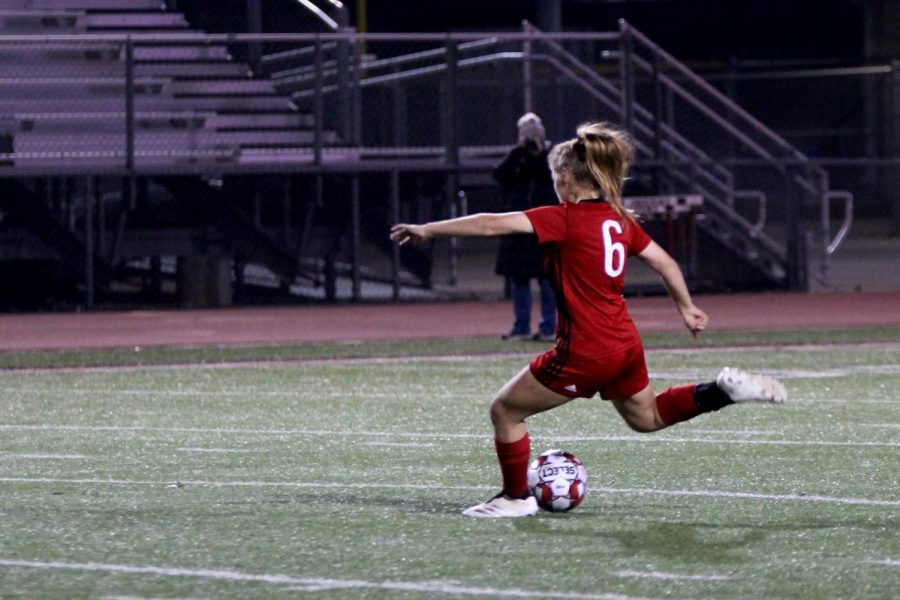 Sophomore holding midfielder no. 6 Emma Smith passes the ball to senior Hannah Dunlap. The game tied 0-0 in regulation playing time.