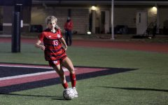 Senior forward no. 13 Hannah Dunlap dribbles the ball. Dunlap scored one of the two goals of the game.
