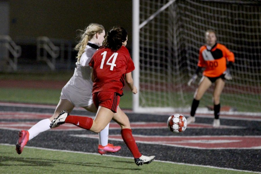 Freshmen outside forward no. 14 Taylor Person attempts to score a goal. The goal was blocked by sophomore goalkeeper no. 0 Cadence Tishler.