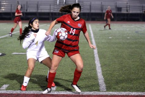 Freshmen outside forward no. 14 Taylor Person blocks sophomore forward no. 4 Brianna Ortega from getting the ball. Person had multiple goal attempts in the game.