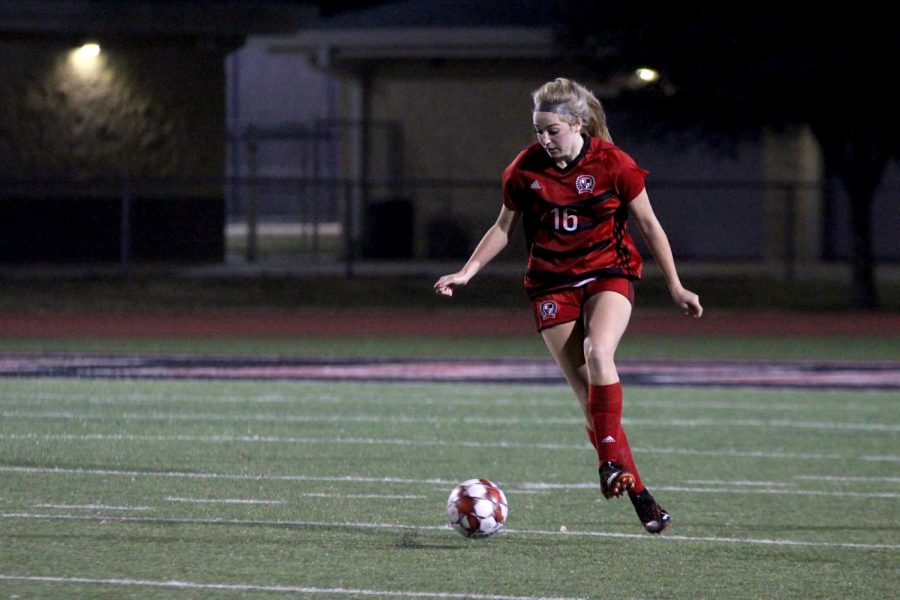 Sophomore left outside defender no. 16 Emmy Woods dribbles the ball. The girls soccer team's record is 6-3 for the season.